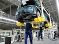 First auto factories resume production